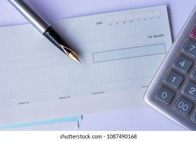 Cheque book  ,calculator and  pen . Business payment in concept.