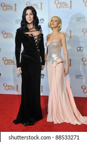 Cher & Christina Aguilera at the 67th Golden Globe Awards at the Beverly Hilton Hotel. January 17, 2010  Beverly Hills, CA Picture: Paul Smith / Featureflash