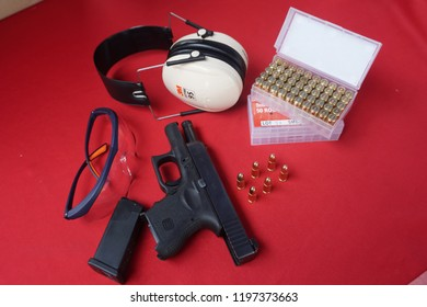 Cheras, Kuala Lumpur, Malaysia, 29 September 2018- Glock pistol handgun with safety tool using while shooting training such as ear bud and glasses for eyes protection bullet.