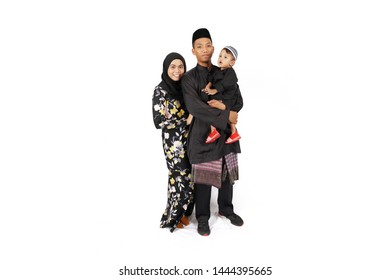 Cheras, Selangor, Malaysia - June 1, 2019 - Muslim happy family portrait with traditional attire isolated on white background .Hari Raya Aidilfitri celebration concept.