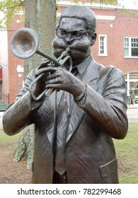 Cheraw, SC / USA - April 2 2016: A statue of native son Dizzy Gillespie stands in the town green of Cheraw, SC.