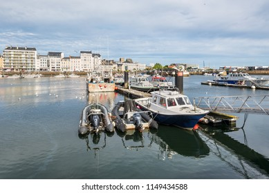 Cherbourg, France - May 22, 2017: Boats in the port of Cherbourg-Octeville, on the north of the Cotentin peninsula, Cherbourg harbour is the biggest artificial harbor in the world.