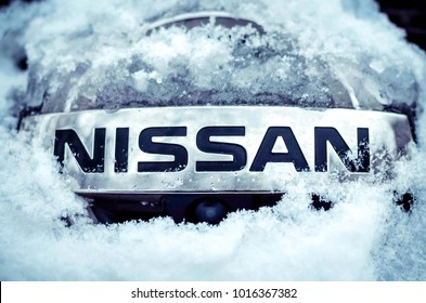 CHEREPOVETS, RUSSIA - JANUARY 28, 2018: Close-up of Nissan logo in snow on a car. Nissan is a Japanese multinational automobile manufacturer.
