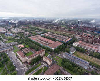 CHEREPOVETS, RUSSIA-CIRCA AUG, 2017: Workshops and smoking chimneys are in the vast territory of the Cherepovets Metallurgical Combine. The CherMK (Steel Mill of PAO Severstal). Aerial view
