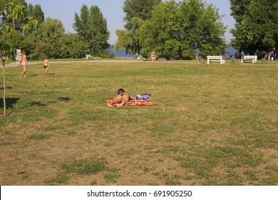 Cherkassy. Ukraine. August 4-2017 : woman in a bathing suit sunbathing in a city park in the heat