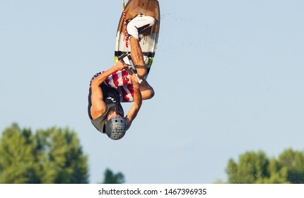 Cherkassy, Ukraine - July 19, 2019: Wakeboarder showing of tricks and skills at wakeboarding event in Cherkassy