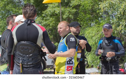 CHERKASSY, UKRAINE- JUNE 1, 2015: Athletes compete during Kite Clash Kiteboarding event in Cherkasy, Ukraine, on June 1, 2015.
