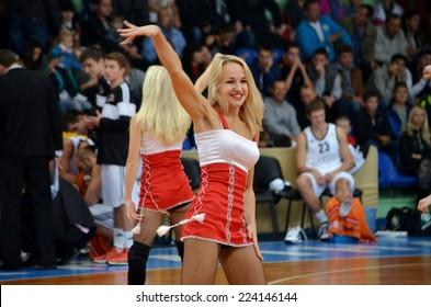 """Cherkassy, UKRAINE - OCT11: Cheerleaders Cherkassky Mavpy dance in a basketball game against BC """"KHIMIK"""", 11 October 2014, SK Budyvelnik, Cherkassy, Ukraine"""