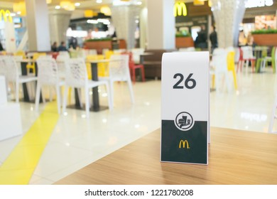 CHERKASY, UKRAINE  – 14 October, 2018:  number plate on table in McDonald's. Waiting for order in the McDonald's restaurant. McDonald's fast food with bill, check.