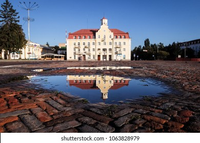 Chernigov Red square after summer rain. Main city square - famous  landmark. Scenic reflections in puddles. Travel in Ukraine.