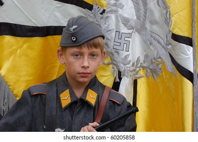 CHERNIGOW, UKRAINE - AUG 29: A member of Red Star military history club wears historical German paratrooper uniform during historical reenactment of WWII, August 29, 2010 in Chernigow, Ukraine