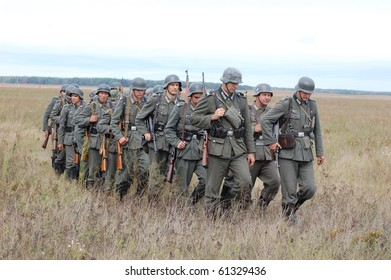 CHERNIGOW, UKRAINE - AUG 29: Members of Red Star military history club wear historical German uniform during historical reenactment of WWII, August 29, 2010 in Chernigow, Ukraine