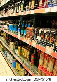 Chernihiv / Ukraine. 03 March 2018: Alcoholic drinks on shelves of supermarket. Different kinds of beer on shelves. Alcoholic beverages section. 03 March 2018 in Chernihiv / Ukraine