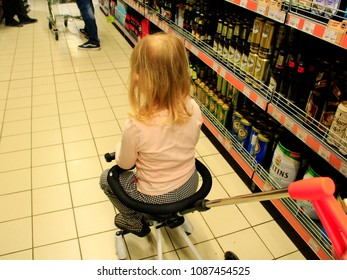 Chernihiv / Ukraine. 03 May 2018: Little child sitting in trolley during family shopping in hypermarket. Shopping in supermarket with children. 03 May 2018 in Chernihiv / Ukraine