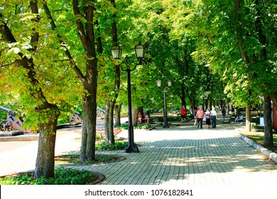 Chernihiv / Ukraine. 05 May 2017: People have a rest in beautiful park. Beautiful city park with promenade path green trees. park in spring. Spring has come to city. 05 May 2017 in Chernihiv/Ukraine