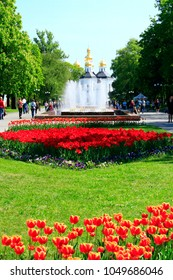 Chernihiv / Ukraine. 06 May 2017: Fountains in city park. People walking along city park in sunny summer day. Summer day in public city park. Lifestyle concept. 06 May 2017 in Chernihiv / Ukraine.
