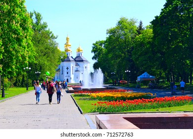 Chernihiv / Ukraine. 06 May 2017: people have a walk in the city park with beds of tulips in the spring. 06 May 2017 in Chernihiv / Ukraine.