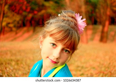 Chernihiv / Ukraine - 07 October 2016: Portrait of young pretty girl in the autumn park. 07 October 2016 in Chernihiv / Ukraine.