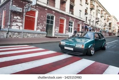 Chernihiv, Ukraine - 07/08/2017. Stance  car Lada 2108 rides near the old building.