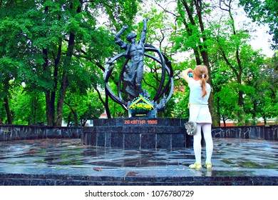 Chernihiv / Ukraine 17 May 2014: Little girl making photo by smartphone of Chernobyl monument. Monument to victims of nuclear disaster in Chernobyl. New generation. 17 May 2014 Chernihiv / Ukraine