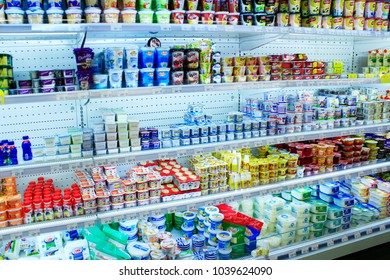 Chernihiv / Ukraine. 26 August 2017: Milk yogurts and others dairy produce on shelves of shop. Shop of dairy products. Wide choice of milky goods. Milky shop. 26 August 2017 in Chernihiv / Ukraine.