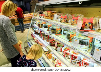 Chernihiv / Ukraine. 26 August 2017: Mother and her daughter choicing cake on shelves of supermarket. Shopping of dessert. Buying food. Family in shop. 26 August 2017 in Chernihiv / Ukraine.