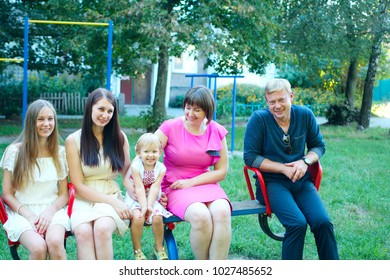 Chernihiv / Ukraine. 27 August 2016: Funny relatives at the party have fun and indulge in a swing. Happy people enjoy life. 27 August 2016 in Chernihiv / Ukraine.