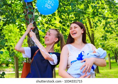 Chernihiv / Ukraine. 27 August 2016: Young beautiful happy girls with newborn baby. Happy relatives. Merry Youth. Laughting girls. Happy family concept. 27 August 2016 in Chernihiv / Ukraine.