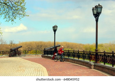 Chernihiv / Ukraine. 28 April 2017: People have a rest in the beautiful park in Chernihiv. Historical park of Chernihiv is named Val promenade path and lanterns. 28 April 2017 in Chernihiv/Ukraine.