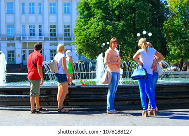 Chernihiv / Ukraine 28 August 2016: People have a rest in city park with fountains. People enjoying weekend in city park near fountains. Hot summer day. 28 August 2016 Chernihiv / Ukraine