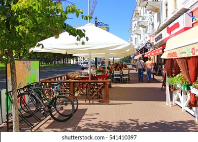 Chernihiv / Ukraine. 28 August 2016: people have a rest in cafe and restaurants outdoors in the central part of Chernihiv. 28 August 2016 in Chernihiv / Ukraine.