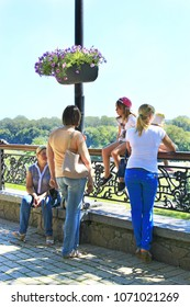 Chernihiv / Ukraine 28 August 2016:People having a rest in city park. Women relaxing in city park in vacations. Summer holidays. Family vacation. Modern women in park. 28 August 2016 Chernihiv/Ukraine