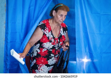 CHERNIHIV, UKRAINE - July 17, 2016: A woman votes at a polling station during local elections in Chernihiv, Ukraine.
