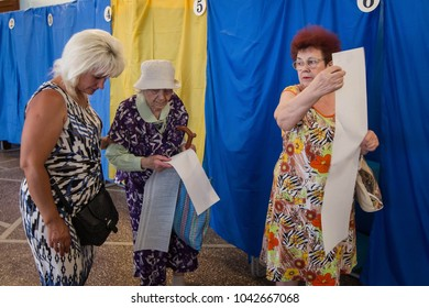 CHERNIHIV, UKRAINE - July 17, 2016: Women vote at a polling station during local elections in Chernihiv, Ukraine.