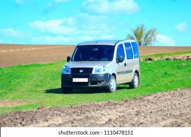 Chernihiv, Ukraine - May 4, 2015: Grey Fiat Doblo cargo van in countryside