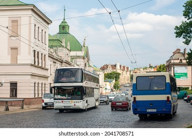 CHERNIVTSI, UKRAINE - August 09, 2021. Buses Neoplan N122 and BAZ-A079 riding with passengers in the streets of Chernivtsi.