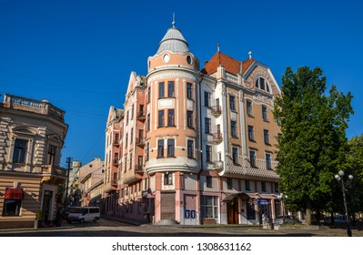 CHERNIVTSI, UKRAINE - AUGUST 9, 2015: The view on the former Hotel Bristol from the Philharmonic square, where tourists and locals like to feed the pigeons