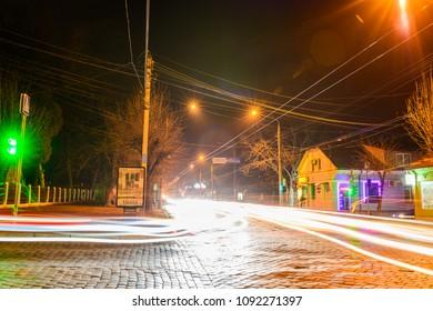 CHERNIVTSI, UKRAINE - DEC 15, 2017: Crossroads near the cardiological hospital. Golovna Street in Chernivtsi. Night lights on the streets of Chernivtsi.