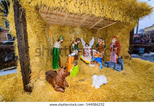 CHERNIVTSI, UKRAINE - DEC 24, 2016:  Christmas manger scene  on Cathedral Square in Chernivtsi. A scene from the biblical story of the birth of Jesus Christ.