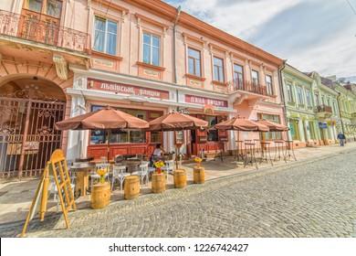 CHERNIVTSI, UKRAINE - DEC 9, 2017: The pedestrian street named Olga Kobylianska. Cafe Drunk Cherry. Architecture in the old town Chernivtsi. Western Ukraine.