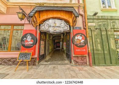CHERNIVTSI, UKRAINE - DEC 9, 2017: The pedestrian street named Olga Kobylianska. Courtyard with a cafe. Architecture in the old town Chernivtsi. Western Ukraine.