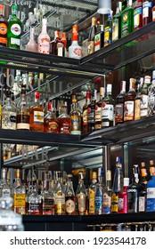 """Chernivtsi, Ukraine. February 8, 2021. Bar: """"Bla Bla Bar"""". University Street, 7.2. Alcohol bottles on shelves behind bar counter."""
