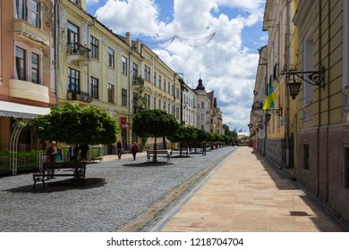 Chernivtsi, Ukraine, July 1, 2018 Kobylyanskaya pedestrian street. Well-maintained alley with trees and benches
