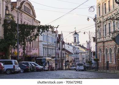 CHERNIVTSI, UKRAINE - July 2017: Evening street in Chernivtsi, Ukraine. Chernivtsy downtown historical architecture by evening, Ukraine