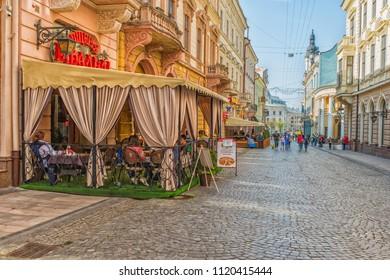 CHERNIVTSI, UKRAINE - JUN 2, 2018: Street cafe. The pedestrian street named Olga Kobylianska. Architecture in the old town Chernivtsi. Western Ukraine. Day of the city.