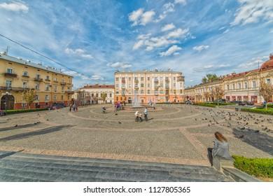 CHERNIVTSI, UKRAINE - JUN 2, 2018: Fountain in the Philharmonia square. Architecture in the old town Chernivtsi. Western Ukraine.