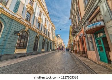 CHERNIVTSI, UKRAINE - JUN 2, 2018: The pedestrian street named Olga Kobylianska. Architecture in the old town Chernivtsi. Western Ukraine.