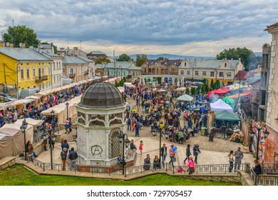 CHERNIVTSI, UKRAINE - OCT 7, 2017: Saint Maria's place. The Turkish plaza. Visitors to the city walk on the city square.  Architecture in the old town Chernivtsi. Western Ukraine. Day of the city.
