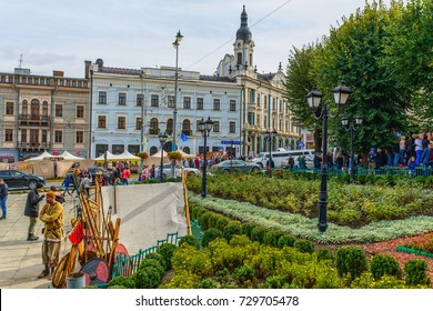 CHERNIVTSI, UKRAINE - OCT 7, 2017: The central square. Tourists are walking around the city.  Architecture in the old town Chernivtsi. Western Ukraine. Day of the city.