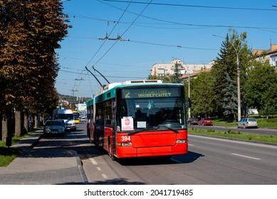 CHERNIVTSI, UKRAINE - September 07, 2021. Trolleybus Hess SwissTrolley 2 #394 (ex. Biel #85) riding with passengers in the streets of Chernivtsi.